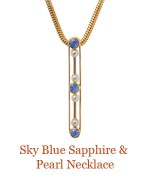 """This deco bar pin is set with  luscious sapphires that bring to mind the dreamy color of the sky on a day with the fog rolling in and out.  - overall length of pendant 1"""", suspended from a removable 14k, 18"""" snake chain. $1,200.00"""