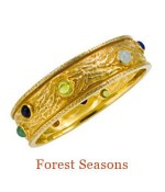 "This heavy bangle's inspiration comes from a lifetime of living with the beautiful evergreen and deciduous trees of Oregon.  The variety of colored 6mm cabochons and the bark-like texture reflect the changing colors of the seasons. It can be had in gold vermeil (shown), 14k, or 18k gold. - diameter, 2.5"" please inquire for pricing."