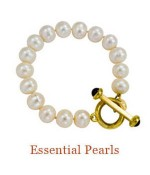 "Hand-knotted freshwater pearls in a substantial size coordinate with the Essential Pearls Necklace. The 18k Cristen Toggle Closure is shown with two onyx cabochons. Other gems may be chosen for the toggle. - Pearls, 10mm - overall length, 7.5""  $1,500.00"