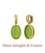 "At first glance a gorgeous splash of fresh green.  Upon closer inspection, an Italian glass cameo of an ancient holding the front paws of what was even then man's best friend.  18k bezels swing from 18k Cristen Snuggie Hoops.- overall length, 1.2""  $2,200.00"