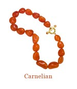 """Hand Knotted large asymetrical beads, 22mm-28mm, with 18k Cristen Toggle Clasp accented by two cabochon Carnelians. - overall length, 18"""",  $1,500.00"""