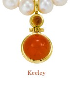 """A large round 16MM carnelian cabochon swings on a hinge below a 6mm cognac quartz bullet. Fitted with an enhancer, it can be worn on many different necklaces be they beads or chains.  All in 18k yellow gold, striking indeed. - overall length, 1.6""""  $1,800.00"""