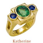 The brilliant cut center stone, a copper green Mozambique tourmaline, the accent stones, two cornflower blue sapphires, the setting, very substantial 18k yellow gold. The design, a Modern Classic with enduring style. 18k  $7,500.00